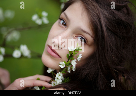 Girl with cherry blossoms, portrait - Stock Photo