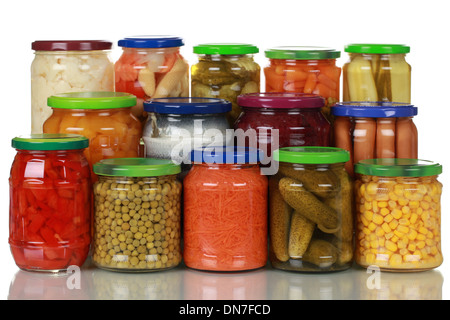 Canned vegetables in glass jars, isolated on white - Stock Photo