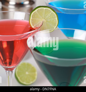 Cocktails such as Cosmopolitan and Blue Curacao in glasses - Stock Photo