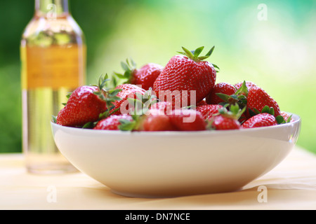 Fresh strawberries in a bowl - Stock Photo