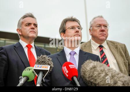 Belfast, Northern Ireland. 20 Dec 2013 - Jonathan Bell, Jeffrey Donaldson and Mervyn Gibson arrive to represent - Stock Photo