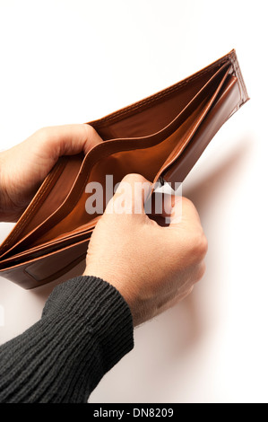 man showing an empty wallet - Stock Photo