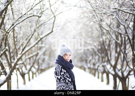 Portrait of a young woman in snow - Stock Photo