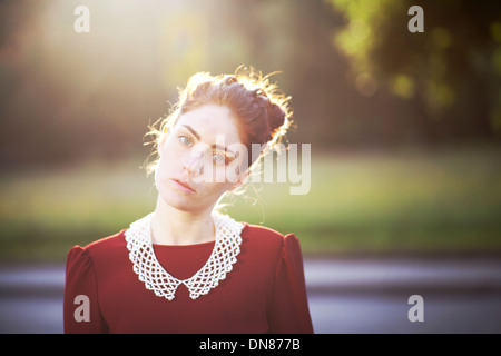 Young woman with serious expression, portrait - Stock Photo