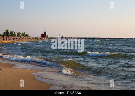 The beach at Holland State Park with the Big Red lighthouse in the distance Stock Photo