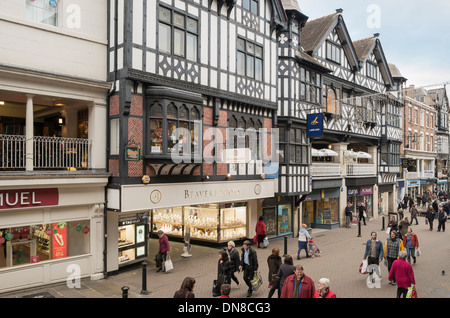 Street scene with shoppers by Beaverbrooks jeweler's shop in city centre. Eastgate Street, Chester, Cheshire, England, - Stock Photo