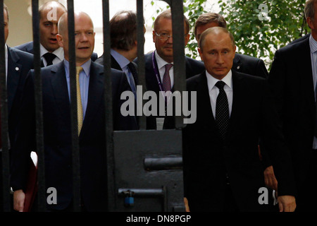 British Prime Minister David Cameron meets Russian President Vladimir Putin - Stock Photo