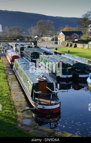 Narrowboats moored for winter at Trevor Canal Basin on the Llangollen Canal in Wales Uk - Stock Photo