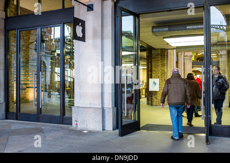 Man entering the Apple store in Covent Garden, London - Stock Photo