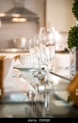 A kitchen with glasses laid on a table - Stock Photo