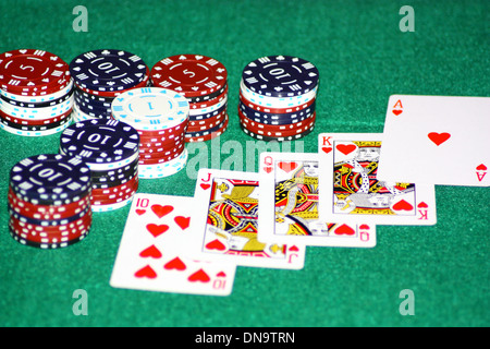An image showing the concept of winning and success with a hand of cards to take the pot - Stock Photo