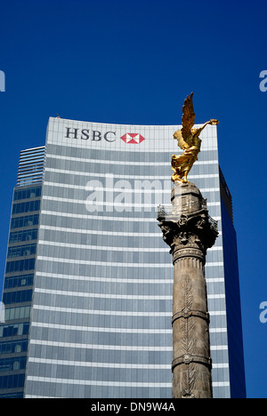 Angel of Independence Angel de Independencia statue with HSBC Mexico Head Office in background - Stock Photo