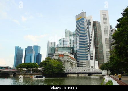 Anderson Bridge in front of Central Singapore. Singapore. Singapore River. - Stock Photo