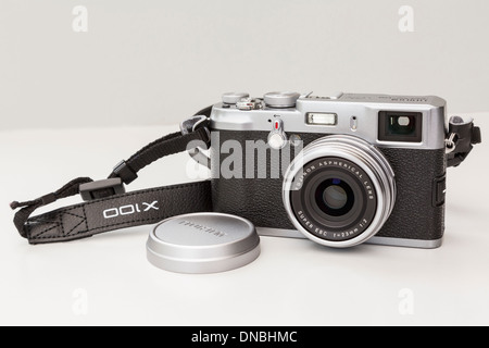 Fujifilm X100 traditional style retro compact digital camera with a fixed lens. - Stock Photo