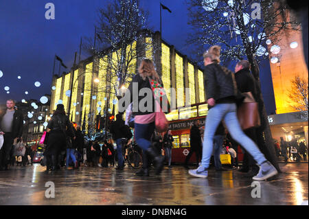 Oxford Street, London, UK. 21st Dec 2013. Late night, last minute Christmas shoppers in central London. Credit: - Stock Photo