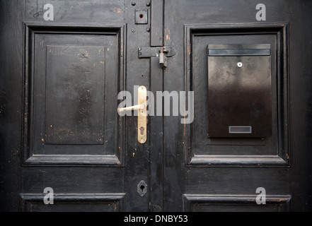 closed door with padlock and handle - Stock Photo