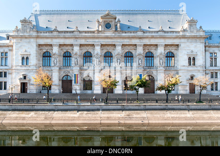 The Palace of Justice on the south bank of the Dâmbovița River in Bucharest, the capital of Romania. - Stock Photo