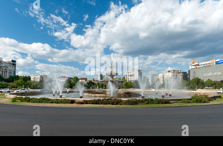 The fountains of Piața Unirii (Unification Square) in Bucharest, the capital of Romania. - Stock Photo