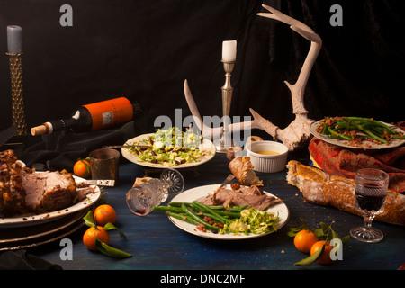 Pork roast after math dinner still life - Stock Photo