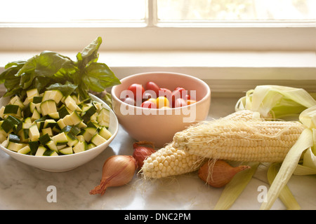 Fresh vegetables by the window - Stock Photo