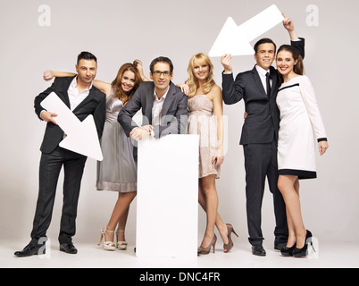 Group of attractive young people pointing vectors - Stock Photo