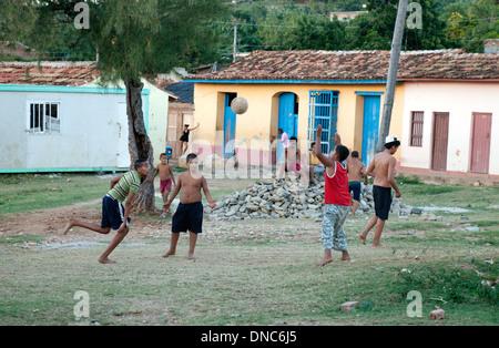 Children playing football soccer , Trinidad, Cuba Caribbean Latin America - Stock Photo