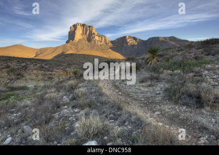 A trail leads to the famous El Capitan under the shadow of Texas' tallest peak, Guadalupe Peak in Guadalupe Mountains - Stock Photo