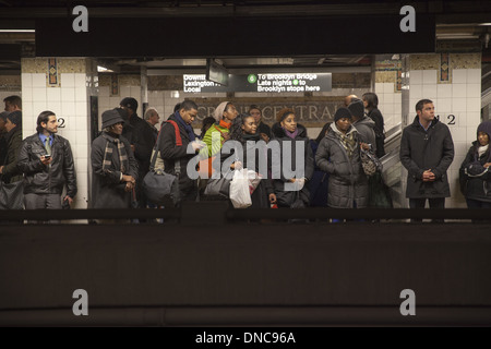 Riders wait on the platform for the train and Grand central Station, NYC. - Stock Photo
