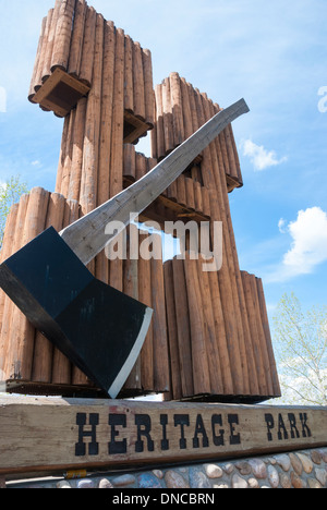The large axe and letter 'H' at the entrance to Heritage Park, a historic village themed tourist site in Calgary - Stock Photo