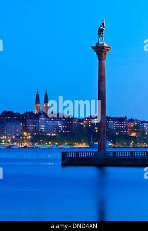 Pillar with statue of Engelbrekt Engelbrektsson at the City Hall park, Stockholm, Sweden. Södermalm is in the background. - Stock Photo