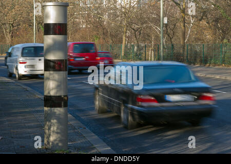 Berlin, Germany. 23rd Dec, 2013. Cars drive past a speed camera column in Berlin, Germany, 23 December 2013. The - Stock Photo