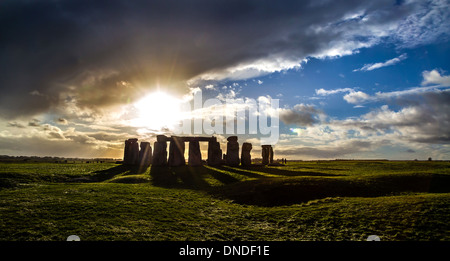 Stonehenge and winter sunset close to the solstice Wiltshire UK - Stock Photo