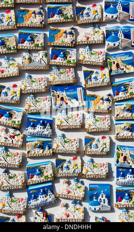 SANTORINI (THIRA), CYCLADES, GREECE. Lots of colourful fridge magnets for sale in a souvenir shop. 2013. - Stock Photo