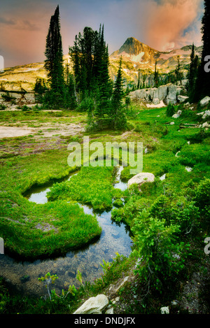 Small stream and meadow with Eagle Cap Mountain. Eagle Cap Wilderness, Oregon - Stock Photo