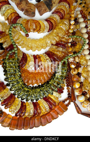 Necklaces of amber on white background - Stock Photo