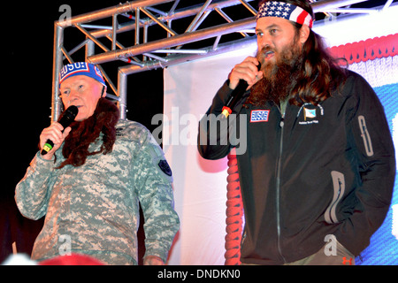 Chairman of the Joint Chiefs General Martin E. Dempsey, right, wears a fake beard as he sings a Christmas song with - Stock Photo