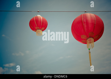 Red Chinese Paper Lanterns against a Blue Sky. Horizontal filtered shot - Stock Photo