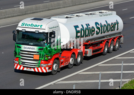 Eddie Stobart articulated fuel delivery truck and tanker trailer on motorway - Stock Photo