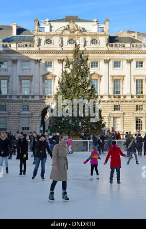 People skating on temporary Christmas ice rink at Somerset House - Stock Photo