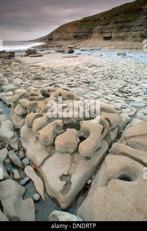 Rock formations at Dunraven Bay, South Wales, are caused by the power of the sea. - Stock Photo