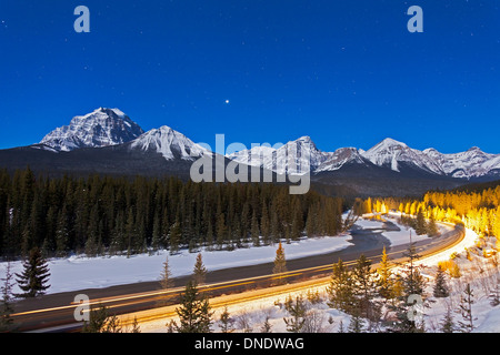 A moonlit nightscape over the Bow River and Morant's Curve in Banff National Park, Canada. - Stock Photo