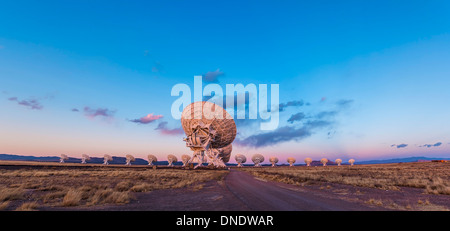 The Very Large Array radio telescope in New Mexico at sunset. - Stock Photo