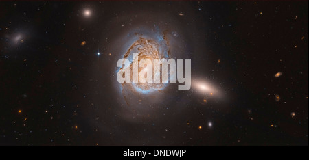 NGC 4911, a spiral galaxy located deep within the Coma Cluster of galaxies in the northern constellation Coma Berenices. - Stock Photo