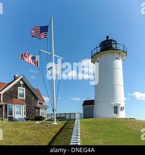 Nobska Point Lighthouse American Massachusetts and Coast Guard flags Woods Hole Falmouth Cape Cod MA USA autumn - Stock Photo