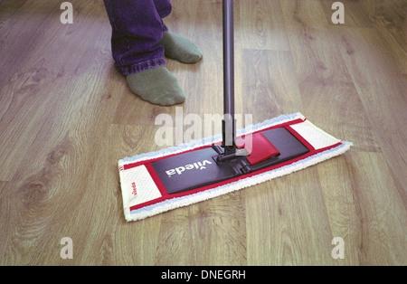 Man Using a Vileda Mop on a Vinyl Wood Effect Floor, UK MODEL RELEASED - Stock Photo