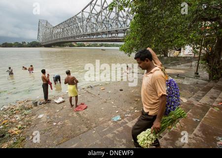 Howrah Bridge near flower market - Calcutta (Kolkata), India - Stock Photo