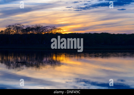 The sun sets over a salt marsh in the late spring in Niantic East Lyme Connecticut United States May 2013. Taken - Stock Photo