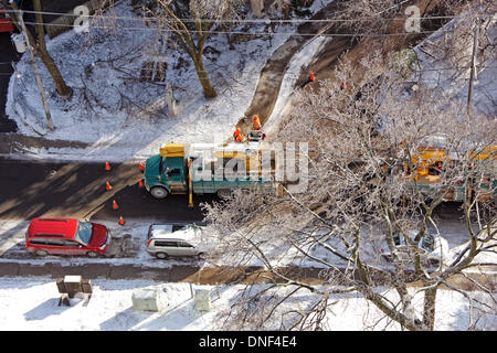 Toronto, Canada. 24th Dec, 2013. Toronto Hydro workers and vehicles busy at restoring electricity supply on Balliol - Stock Photo
