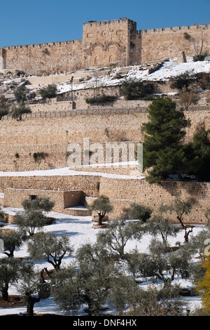 Snow blankets Kidron Valley and the sealed arched Golden Gate or Bab al-Dhahabi in Arabic at the eastern walls of - Stock Photo