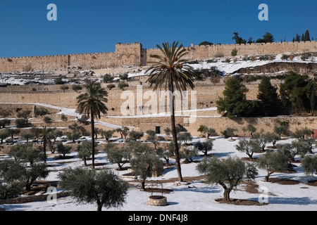 Snow blankets the Kidron Valley or Wadi an-Nar on the eastern side of The Old City of Jerusalem, Israel - Stock Photo